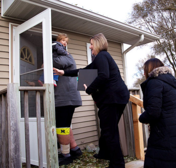 UMCOR case managers make a home visit.