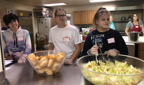 Serving a meal at Troy Big Beaver UMC