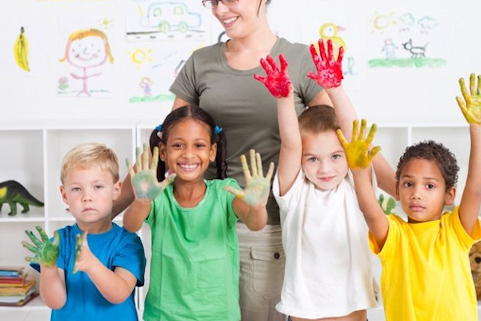 Kids in classroom with paint on hands