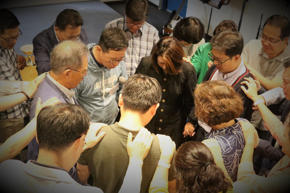 Korean pray for mission future of United Methodist Church.