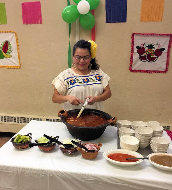 Woman serving Mexican food