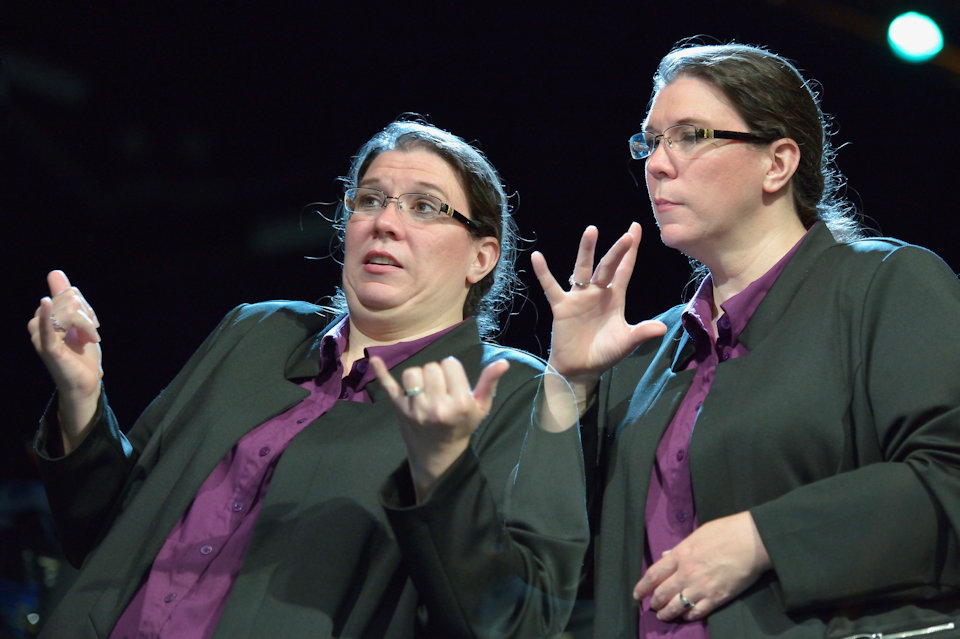 Woman doing sign language interpretation at General Conference 2016