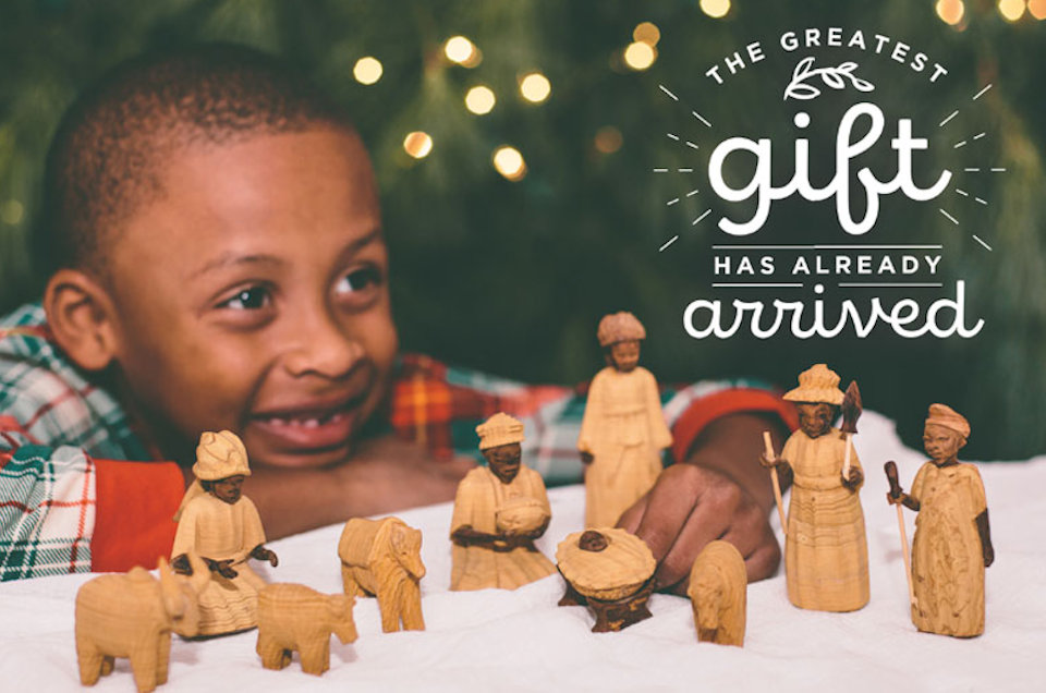 Boy with Nigerian nativity set