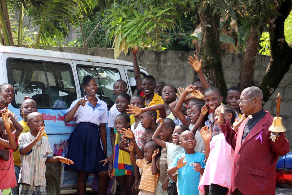 Director and children at Bishop Judith Craig Children's Villlage in Liberia.
