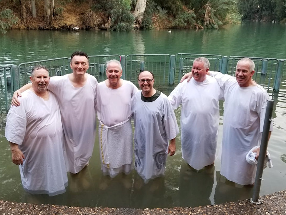 Bishop Bard and others remembering baptism in the River Jordan