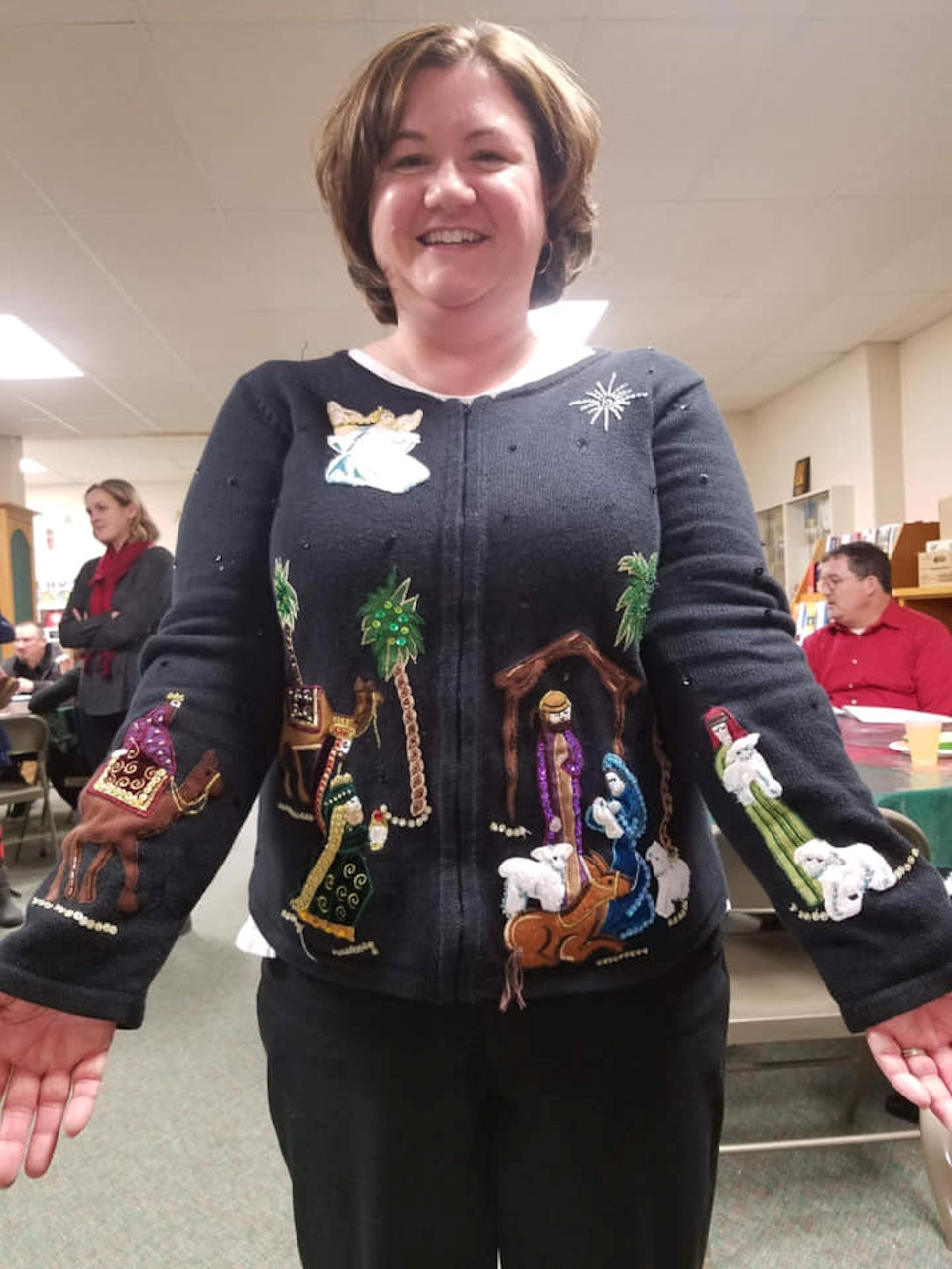 Pastor in nativity sweater