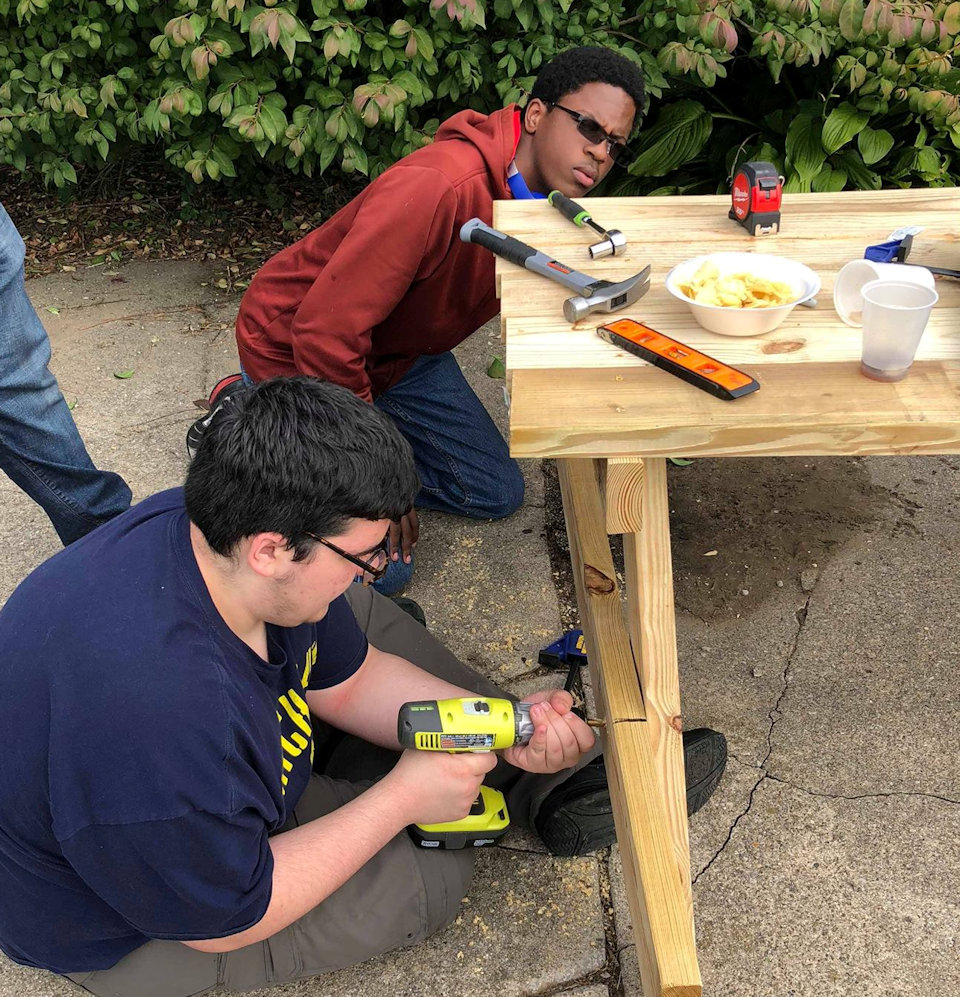 Scouts building picnic tables
