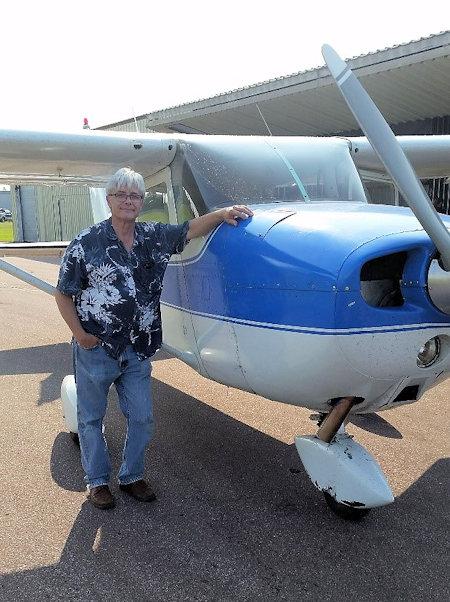 Jerry DeVine next to plane