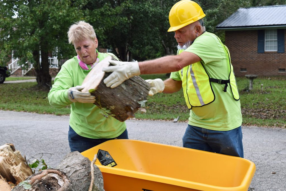 Trained volunteers clean up after Hurricane Florence