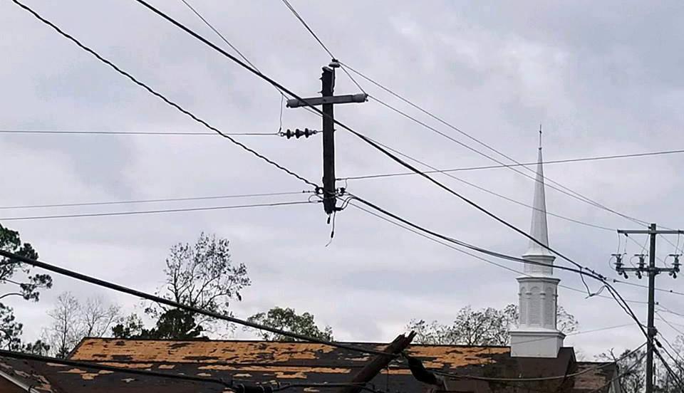 Utility pole shaped like cross