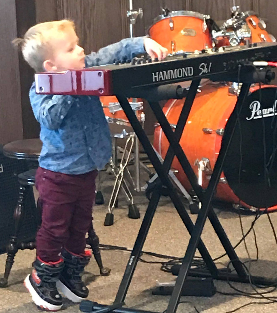 Small boy playing keyboard