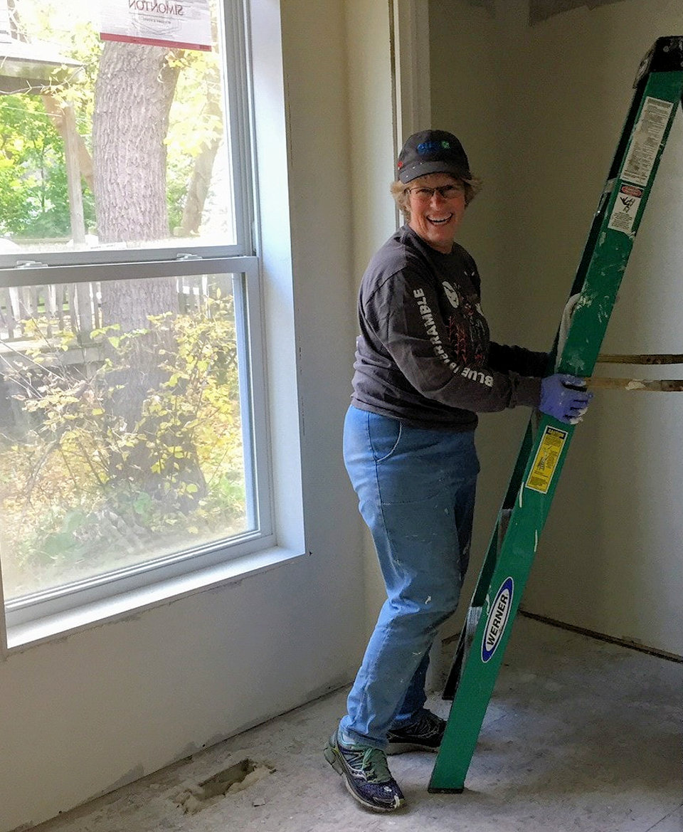 Woman painting for Habitat for Humanity