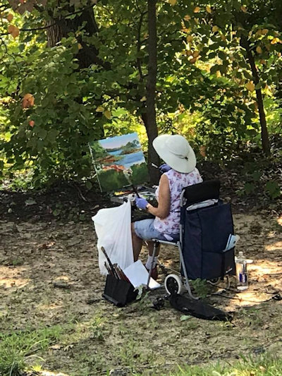 Woman painting at Wesley Woods Camp