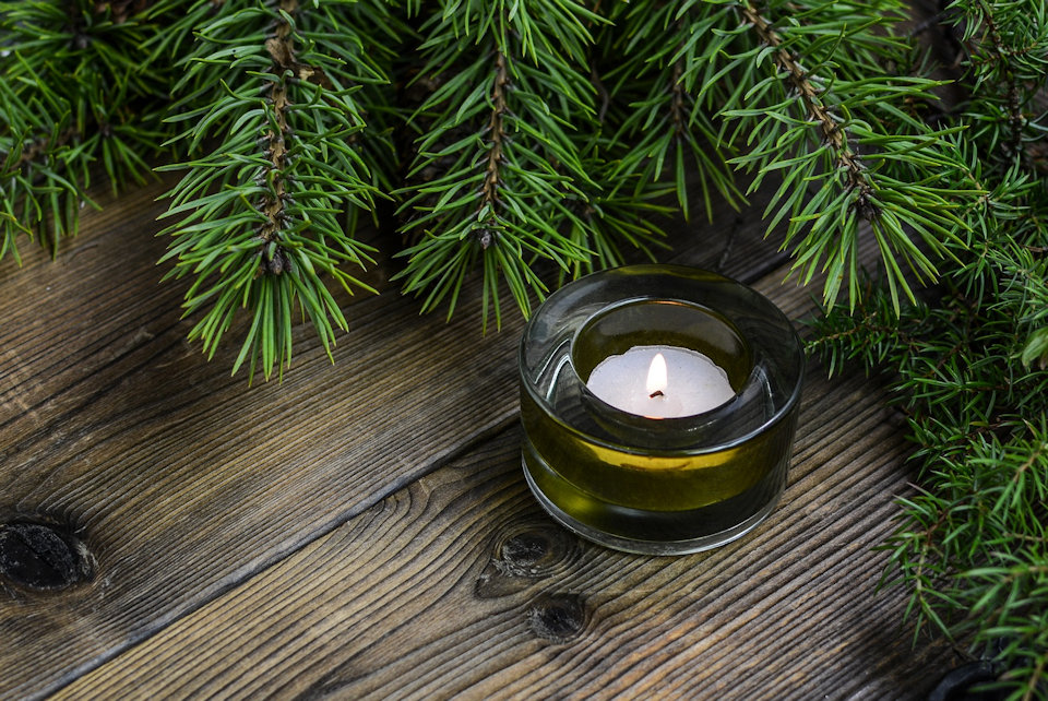 Small candle with pine boughs