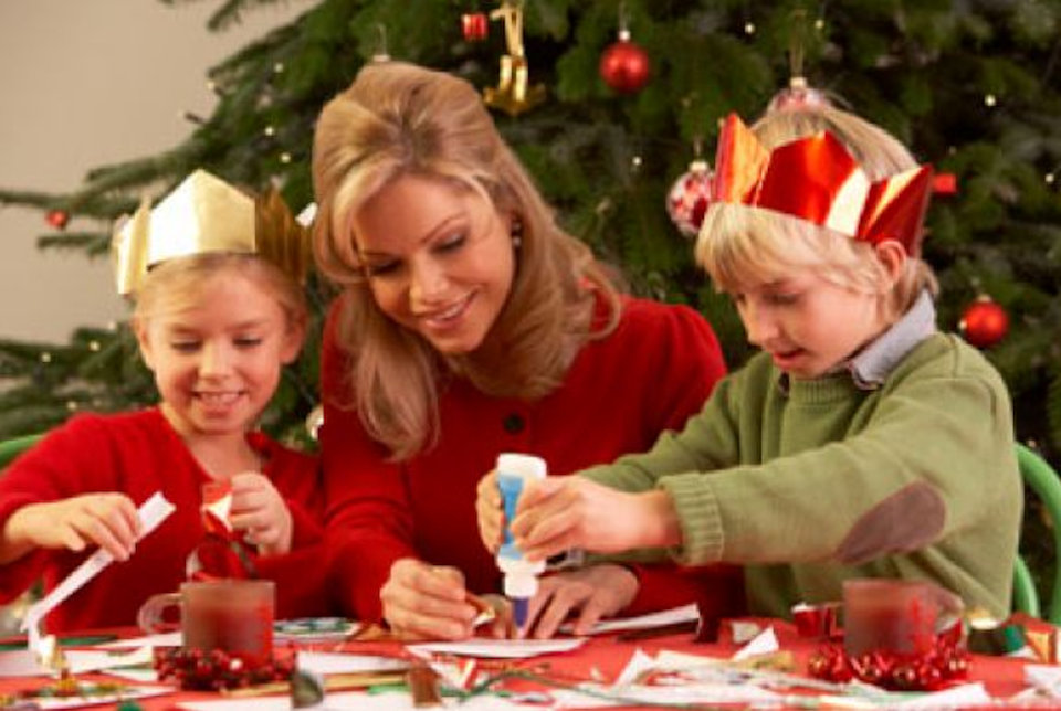 Mother doing Christmas crafts with children