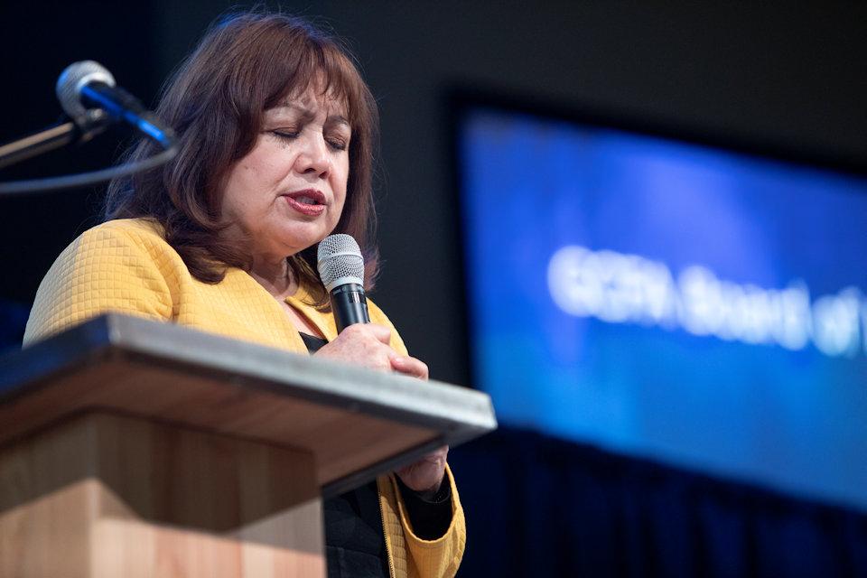 BIshop Minerva Carcano prays for migrants