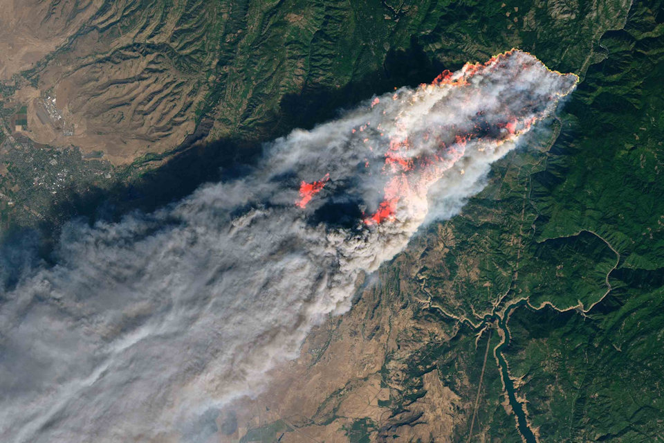 Satellite view of the wildfire overwhelming Paradise, CA