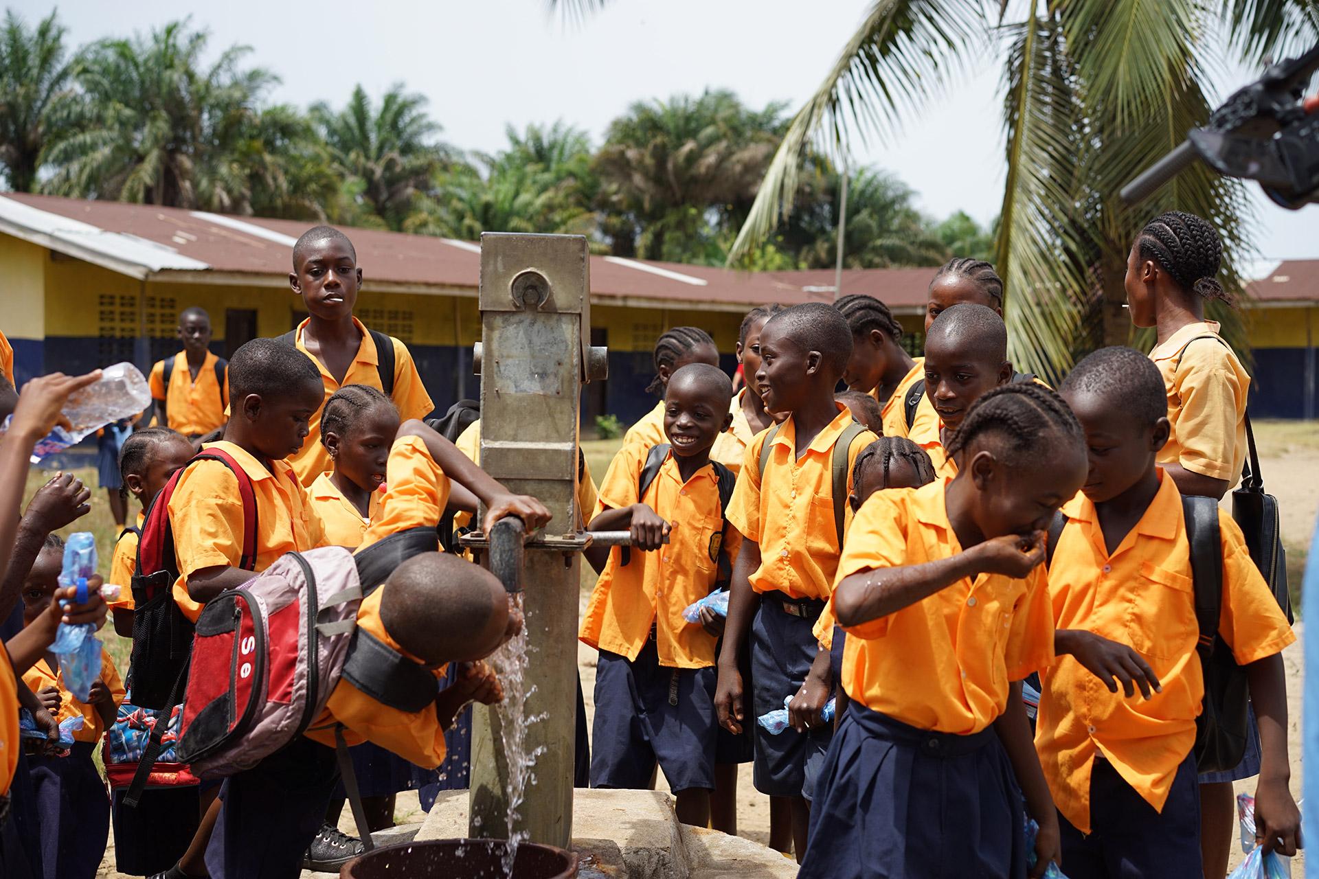 Liberian children drinking clean water