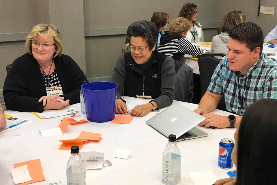 A table group at the 2018 Reach Summit in East Lansing