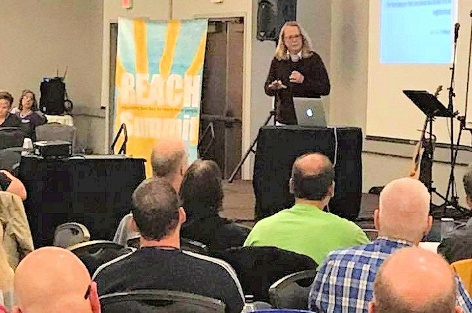 Keynote speaker Elaine Heath leads a session of the 2018 REACH Summit