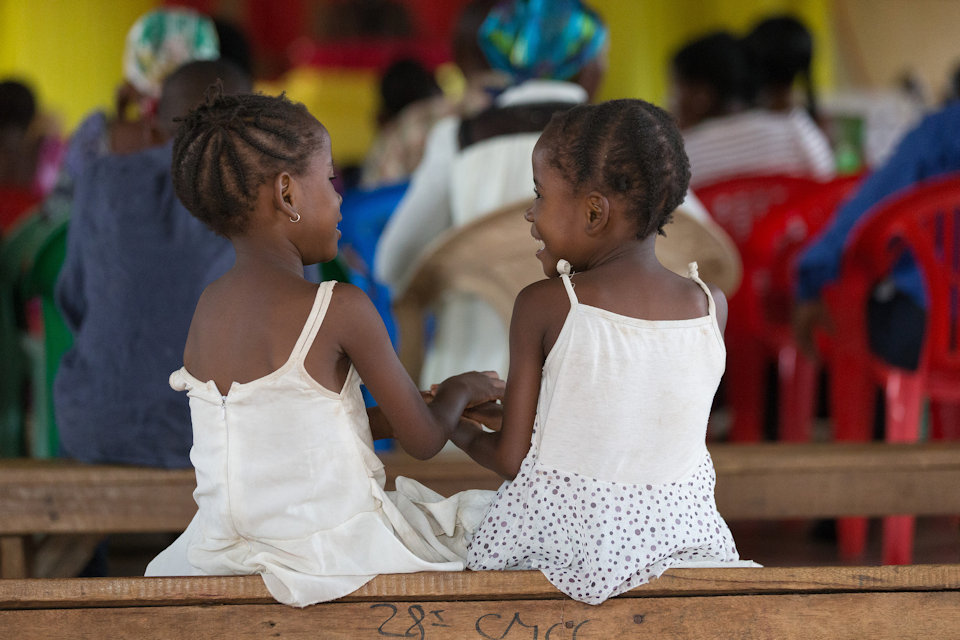 Two little girls in church in DR Congo.