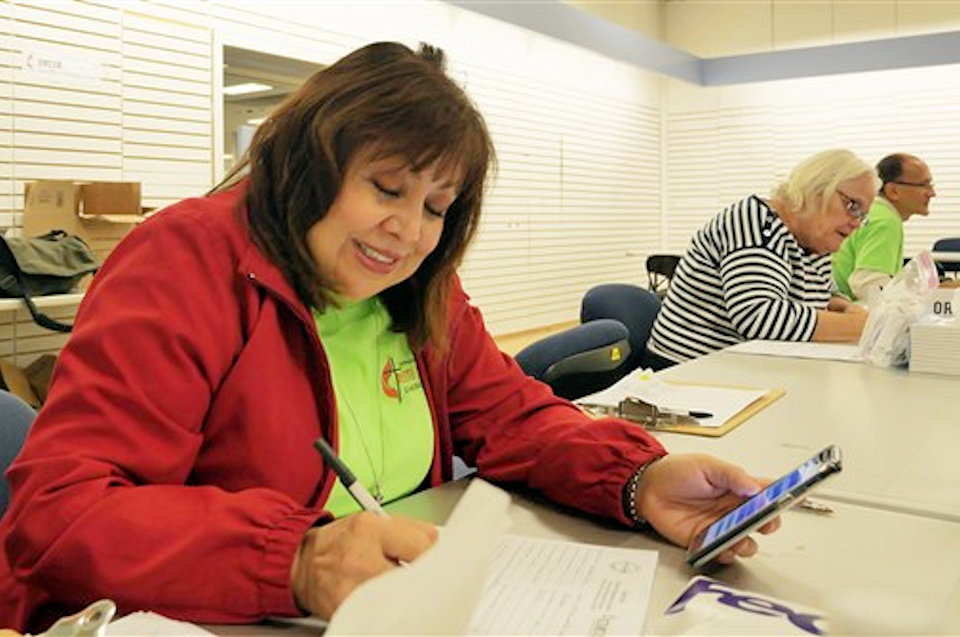 Bishop Minerva Carcaño working at the Disaster Response Center in California.