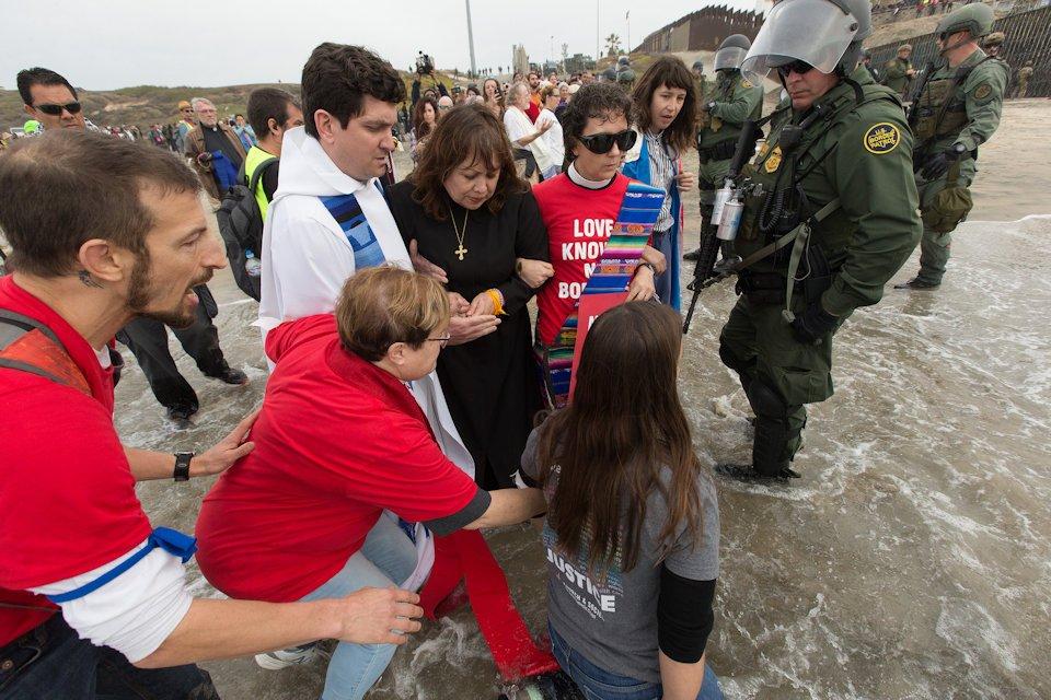 Rev. Jill Zundel among those kneeling in the Pacific Ocean to pray
