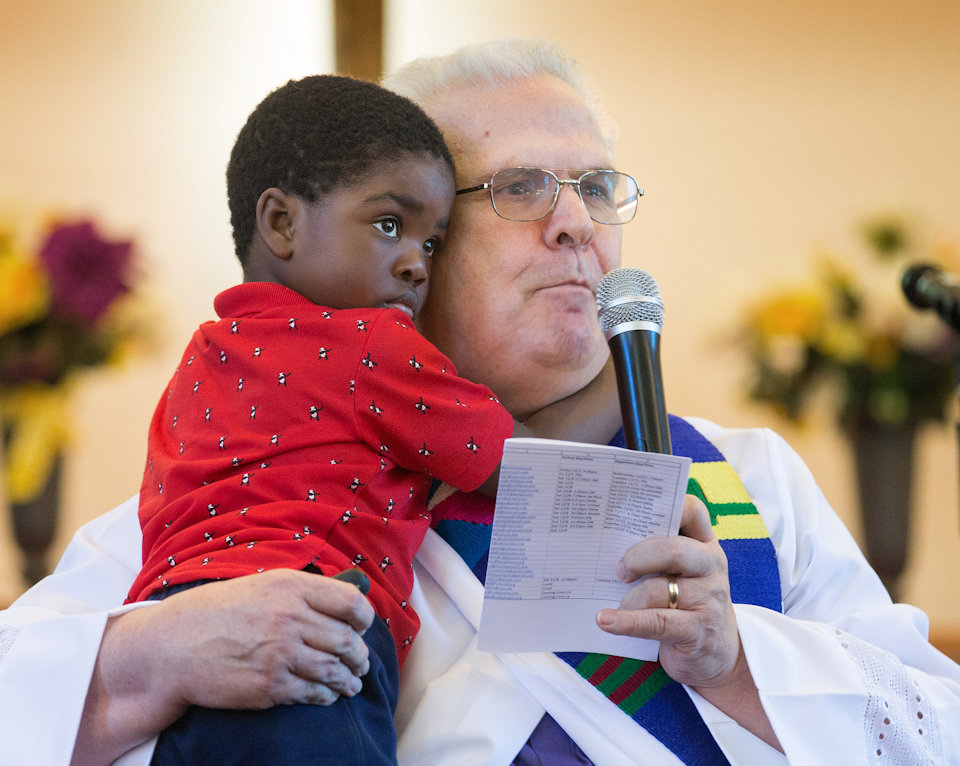 Rev. Bill Jenkins holds his foster son, Harry.