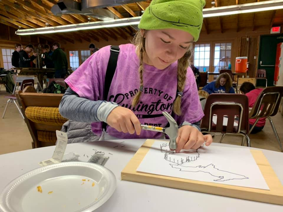 Young woman doing crafts at camp