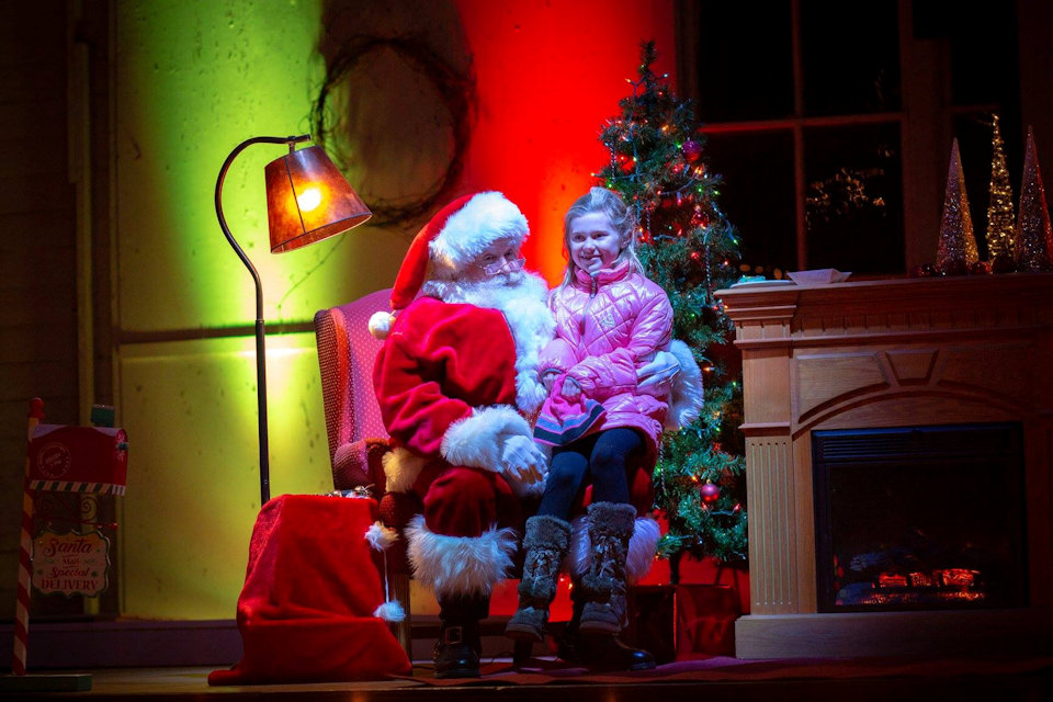 Girl visits Santa at Crystal Springs Camp