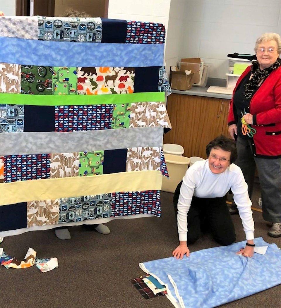 Women making blankets