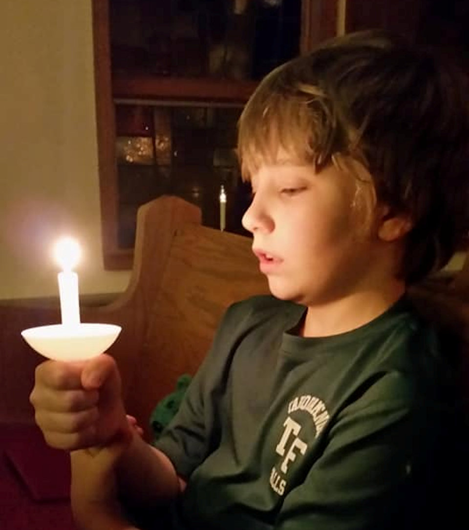 Child with lighted candle
