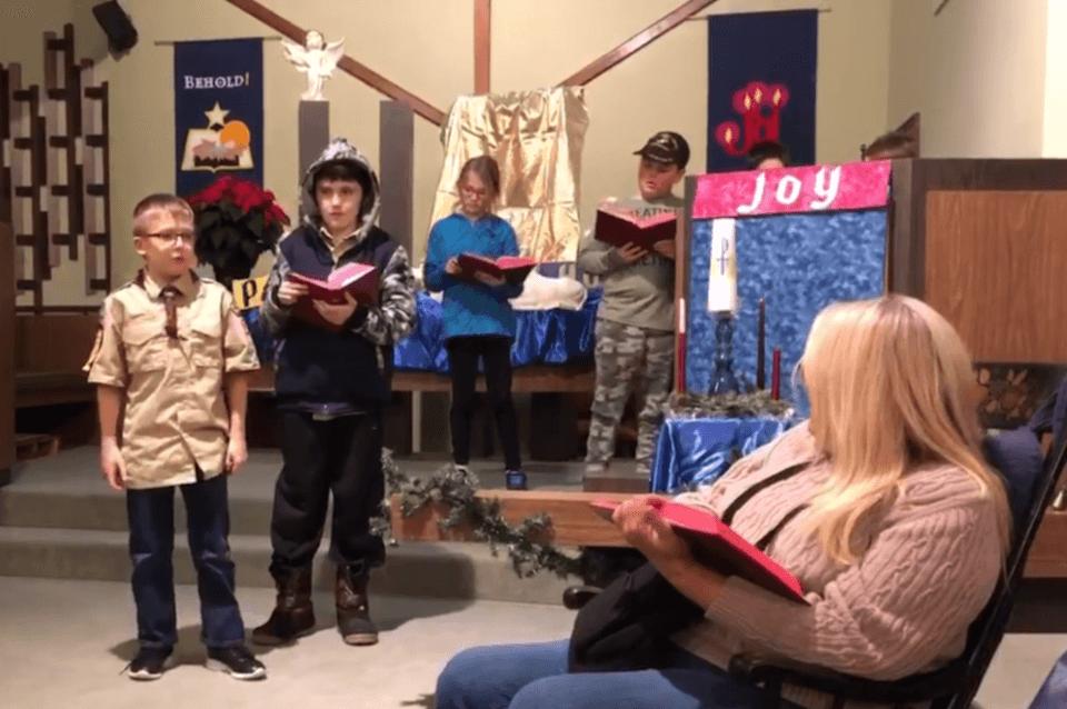 Boy Scouts reading Bible