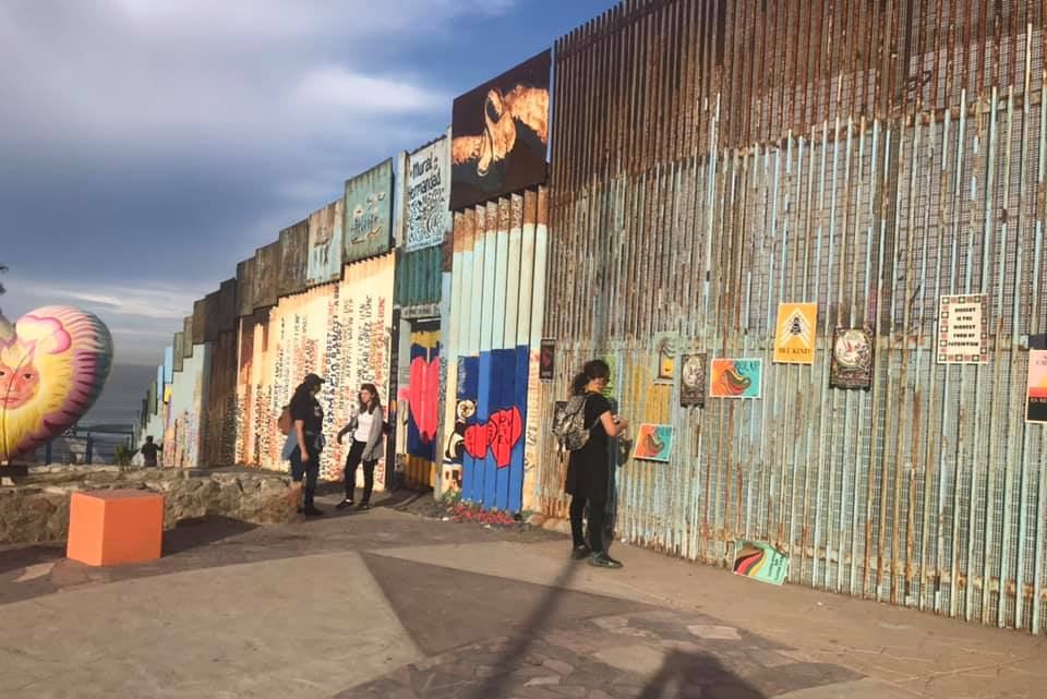 JFON Michigan staff at border wall between Mexico and U.S.