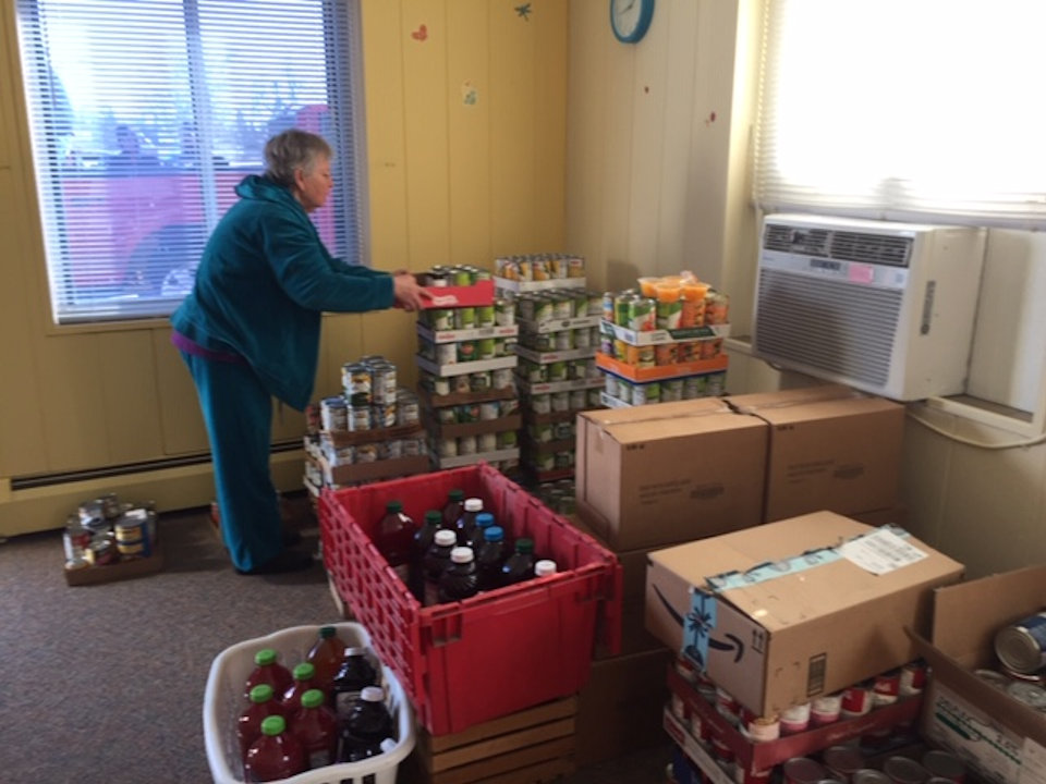 Woman organizing food for flood victims