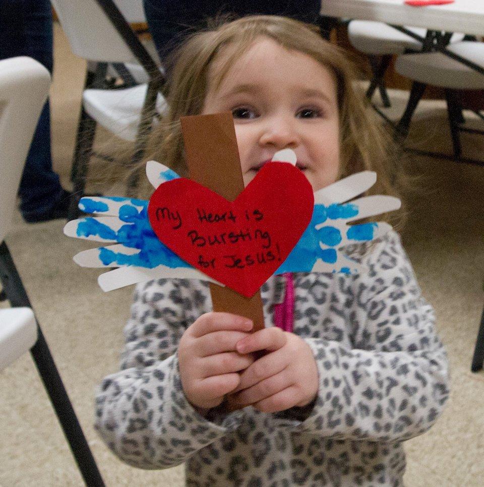 Child with handmade cross