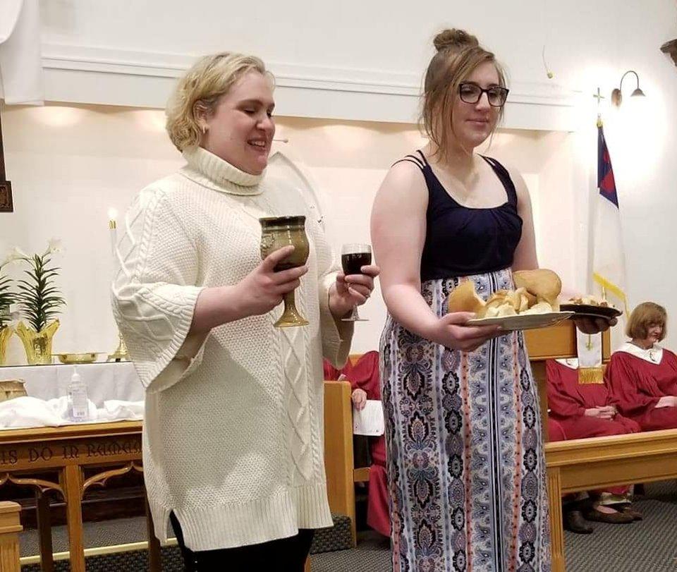 Women serve communion.