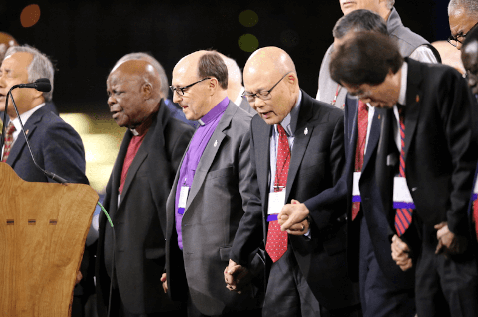 Bishop Bard prays with Council of Bishops at GC 2019