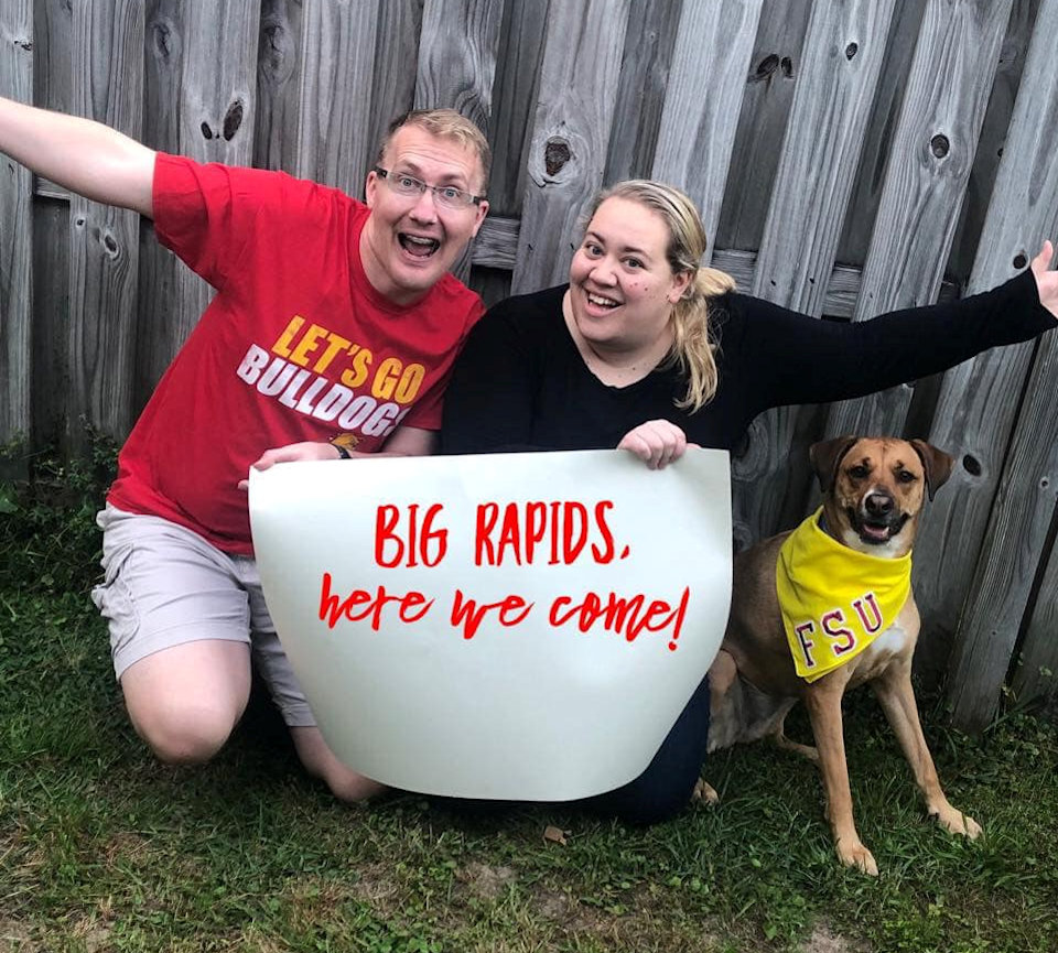 Man, woman and dog moving to Big Rapids.