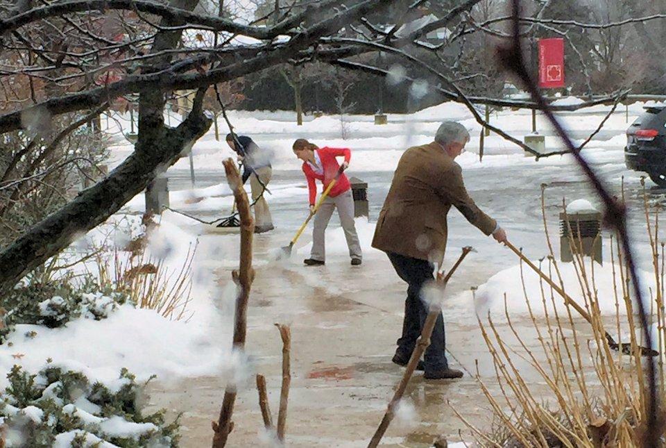 Pastors shoveling snow
