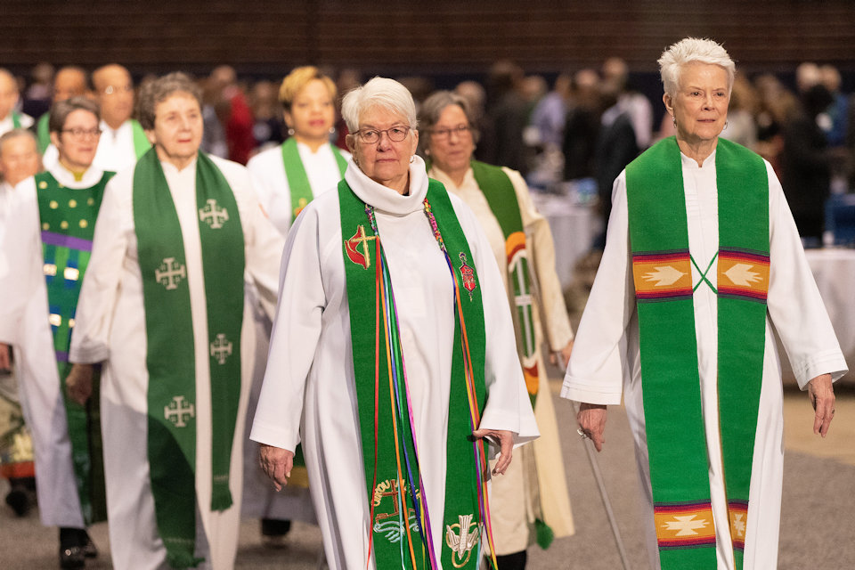 Bishops Deborah Lieder Kiesey and Sharon Rder process into the GC2019 General Conference on Sunday, Februry 24, 2019.