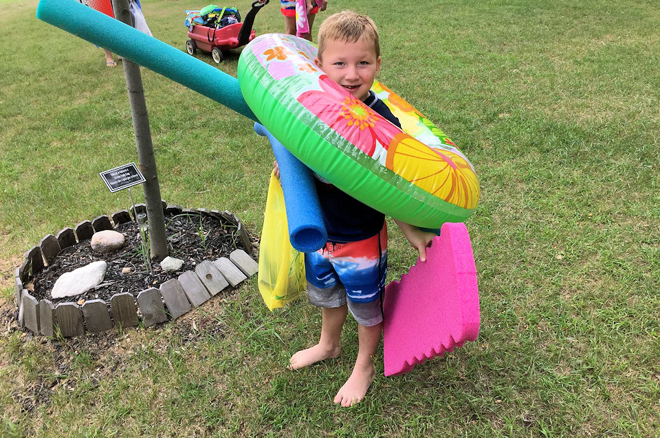 Young boy ready to swim at Lakeview Camp