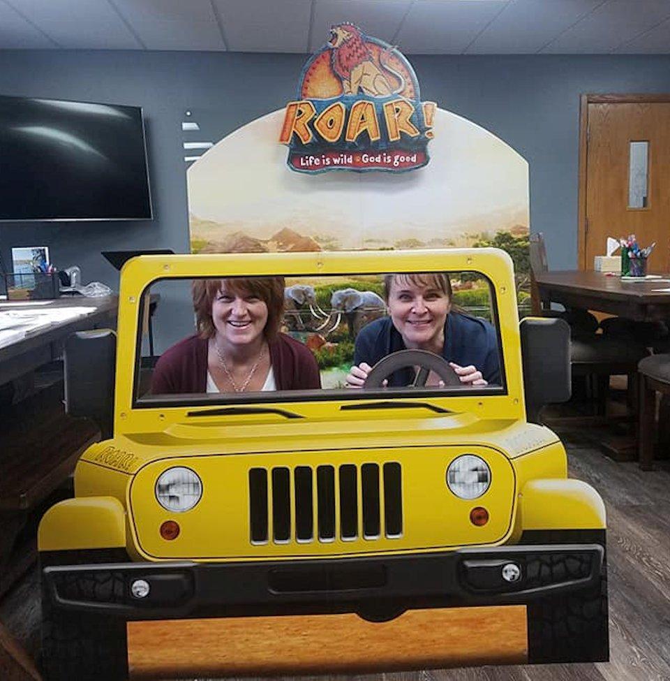 Two women in toy car