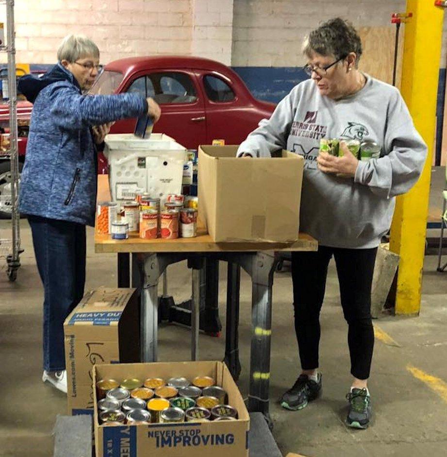 Women sorting groceries
