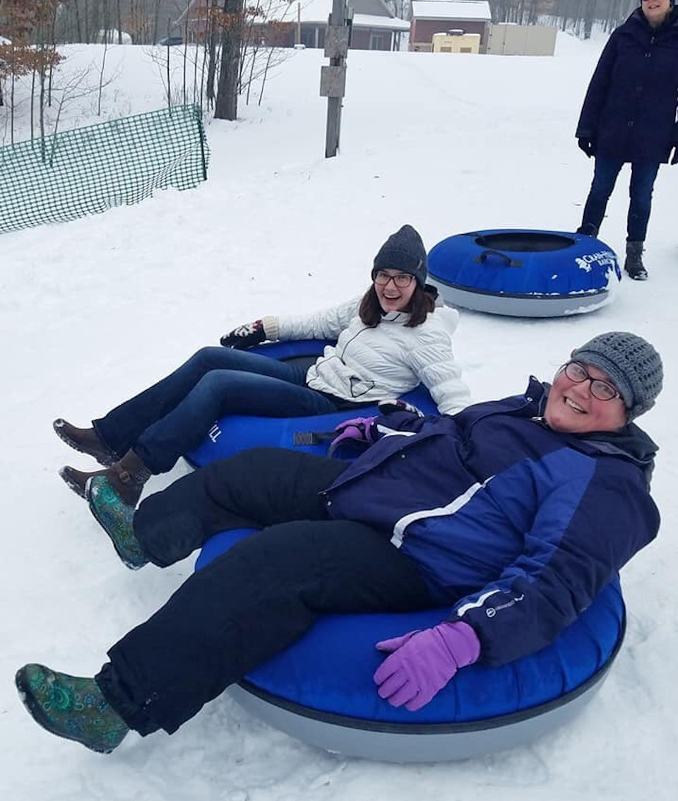 Women in tubes sledding