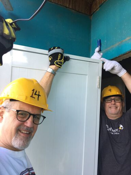 East Winds volunteers work on a home damaged by Hurricane Maria