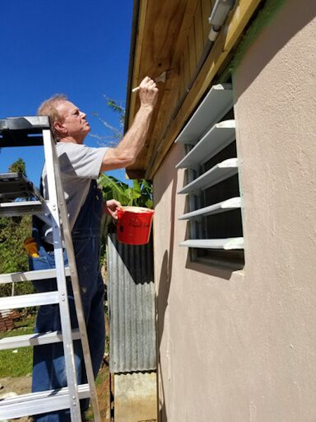 Volunteer painting a home in Puerto Rico