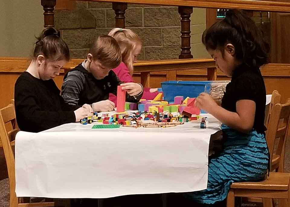 Children in their pray space during worship