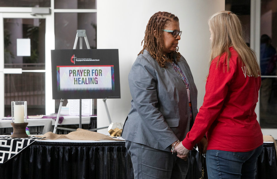 Two women pray in the Prayer Room of GC 2019.