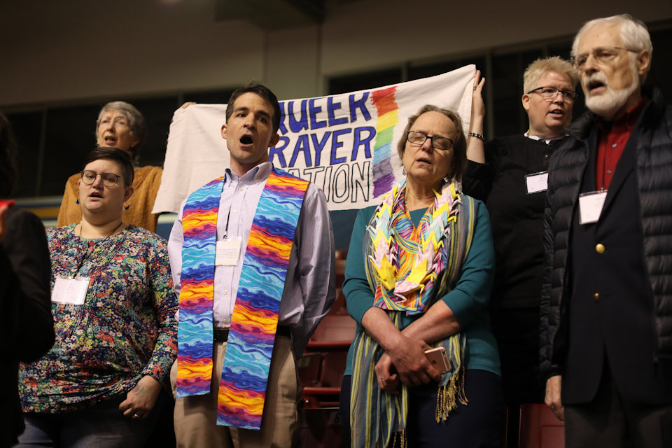 LGBTQ persons at Prayer Station at General Conference